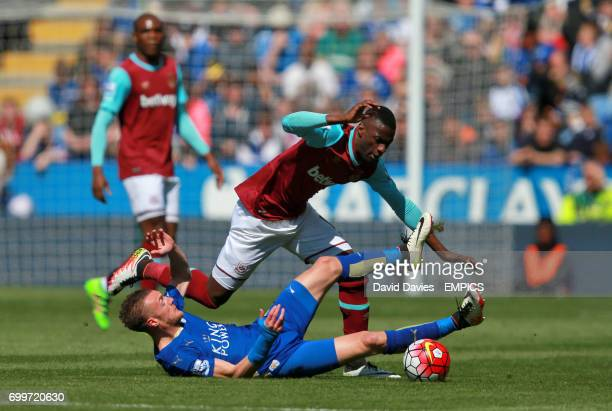 Leicester City's Jamie Vardy and West Ham United's Emmanuel Emenike battle for the ball