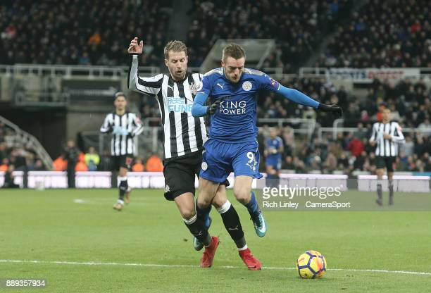 Leicester City's Jamie Vardy under pressure from Newcastle United's Florian Lejeune during the Premier League match between Newcastle United and...