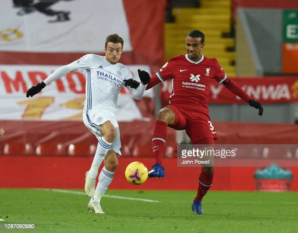 Leicester City's Jamie Vardy with Joel Matip of Liverpool during the Premier League match between Liverpool and Leicester City at Anfield on November...