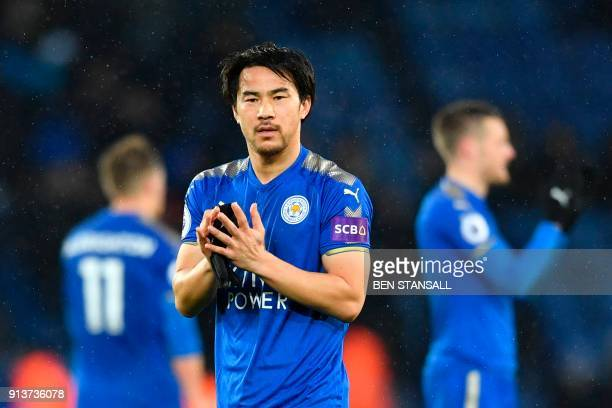 Leicester City's Japanese striker Shinji Okazaki applauds the fans during the English Premier League football match between Leicester City and...