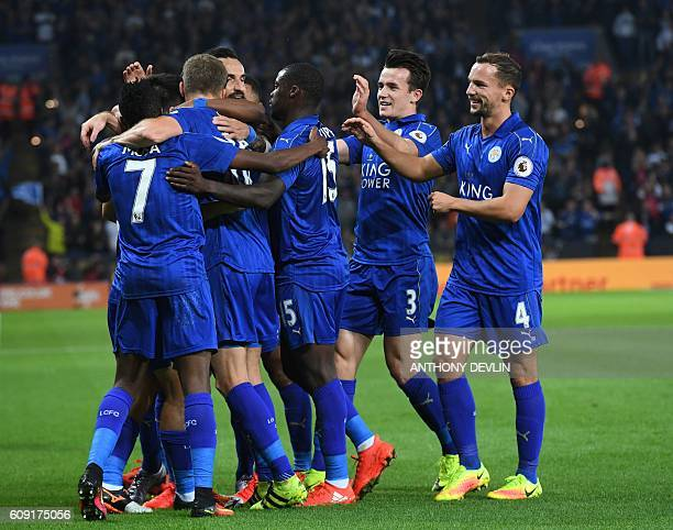 Leicester City's Japanese striker Shinji Okazaki celebrates with teammates after scoring the opening goal of the English League Cup third round...