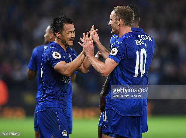 Leicester City's Japanese striker Shinji Okazaki celebrates with Leicester City's Welsh midfielder Andy King after scoring his and Leicester's second...