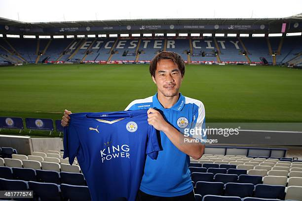 Leicester City's Japanese striker Shinji Okazaki poses for photos during a press conference at King Power Stadium on July 24 2015 in Leicester England