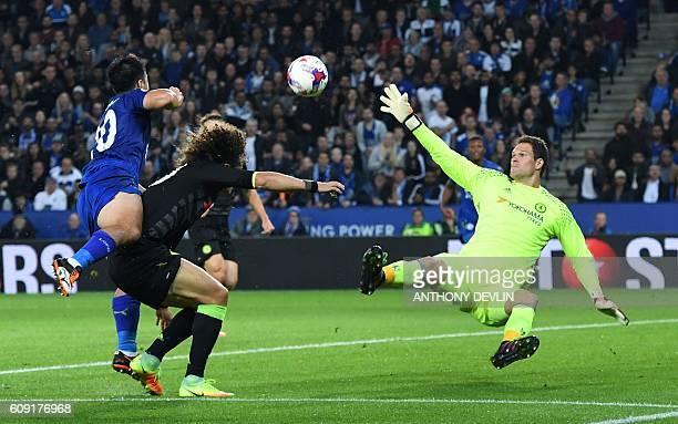 Leicester City's Japanese striker Shinji Okazaki shoots past Chelsea's Brazilian defender David Luiz and Chelsea's Bosnian goalkeeper Asmir Begovic...