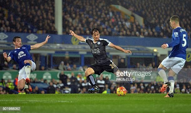 Leicester City's Japanese striker Shinji Okazaki shoots past Everton's English defender Leighton Baines to score their third goal during the English...