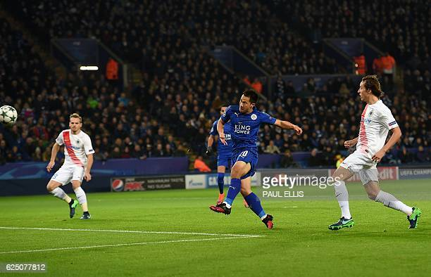 Leicester City's Japanese striker Shinji Okazaki shoots to score his first goal during the UEFA Champions League group G football match between...