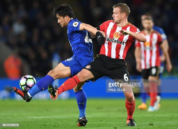 Leicester City's Japanese striker Shinji Okazaki vies with Sunderland's English midfielder Lee Cattermole during the English Premier League football...