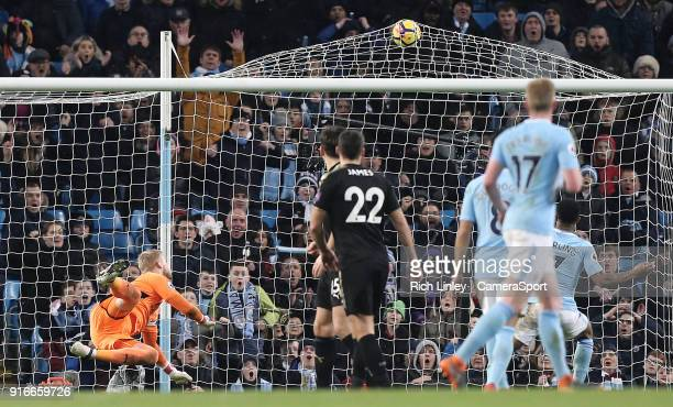 Leicester City's Kasper Schmeichel is beaten by a strike by Manchester City's Sergio Aguero who scored his sides fifth goal during the Premier League...