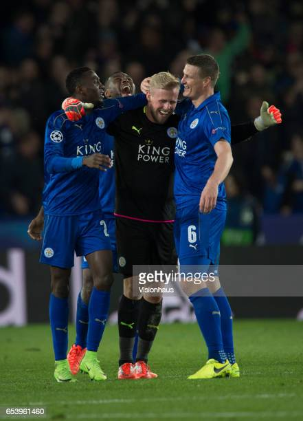 Leicester City's Kasper Schmeichel Wilfred Ndidi Robert Huth and Wes Morgan celebrate at the final whistle after the UEFA Champions League Round of...