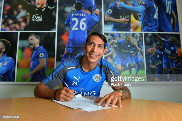 Leicester City's Leonardo Ulloa signs a new contract at Belvoir Drive Training Complex on August 24 2017 in Leicester United Kingdom