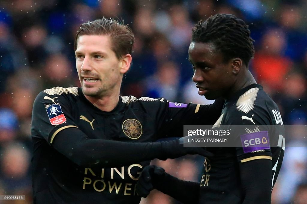 Leicester City's Malian midfielder Fousseni Diabate (R) celebrates scoring their fourth goal during the English FA Cup fourth round football match between Peterborough United and Leicester City at London Road stadium in Peterborough, eastern England, on January 27, 2018. / AFP PHOTO / Lindsey PARNABY / RESTRICTED TO EDITORIAL USE. No use with unauthorized audio, video, data, fixture lists, club/league logos or 'live' services. Online in-match use limited to 75 images, no video emulation. No use in betting, games or single club/league/player publications. /