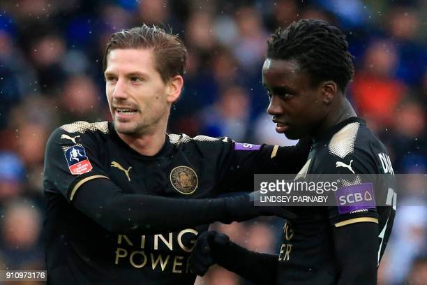 Leicester City's Malian midfielder Fousseni Diabate celebrates scoring their fourth goal during the English FA Cup fourth round football match...