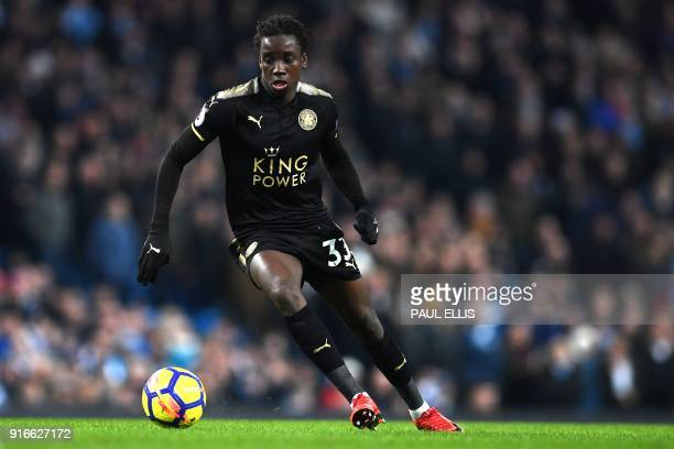 Leicester City's Malian midfielder Fousseni Diabate runs with the ball during the English Premier League football match between Manchester City and...