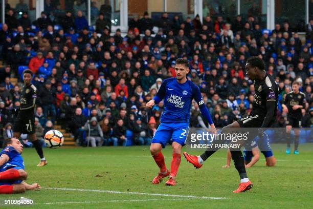 Leicester City's Malian midfielder Fousseni Diabate scores their fourth goal during the English FA Cup fourth round football match between...