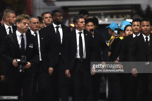 Leicester City's manager Claude Puel and players arrive at Wat Thepsirin Buddhist temple in Bangkok on the second day of funeral ceremony for...