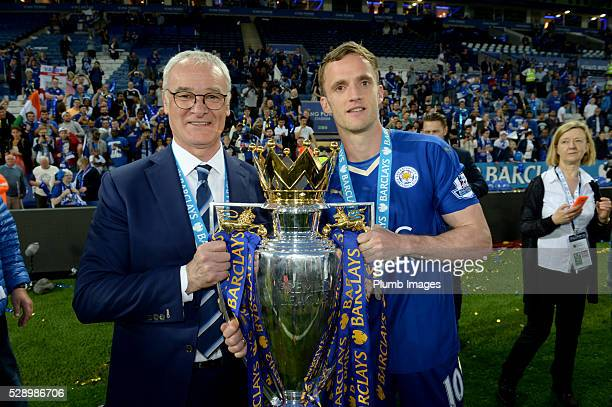 Leicester City's manager Claudio Ranieri and Andy King of Leicester City hold the Barclay Premier League trophy after the Barclays Premier League...