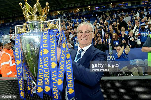 Leicester City's manager Claudio Ranieri holds the Barclays Premier League trophy after the Barclays Premier League match between Leicester City and...