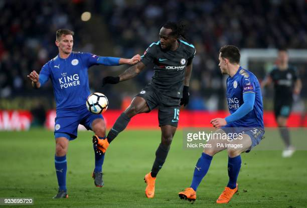 Leicester City's Marc Albrighton and Ben Chillwell and Chelsea's Victor Moses battle for the ball during the Emirates FA Cup quarter final match at...