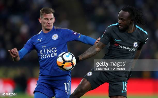 Leicester City's Marc Albrighton and Chelsea's Victor Moses battle for the ball during the Emirates FA Cup quarter final match at the King Power...