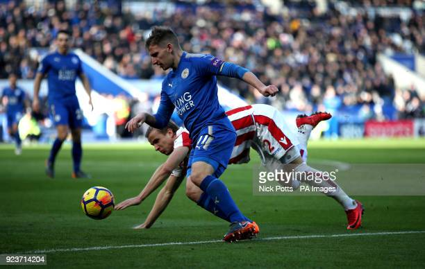 Leicester City's Marc Albrighton and Stoke City's Moritz Bauer battle for the ball during the Premier League match at the King Power Stadium Leicester