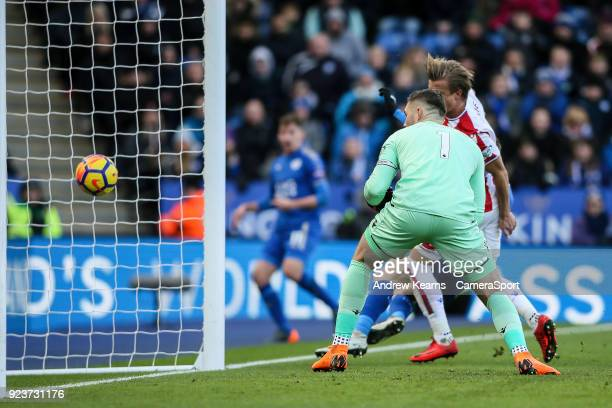Leicester City's Marc Albrighton beats Stoke City's goalkeeper Jack Butland to score his side's first goal during the Premier League match between...