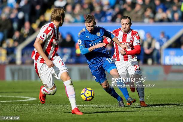 Leicester City's Marc Albrighton breaks under pressure from Stoke City's Moritz Bauer and Xherdan Shaqiri during the Premier League match between...