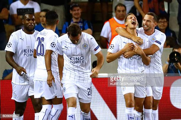 Leicester City's Marc Albrighton celebrates with his teammates after scoring during the UEFA Champions League football match between Club Brugge and...