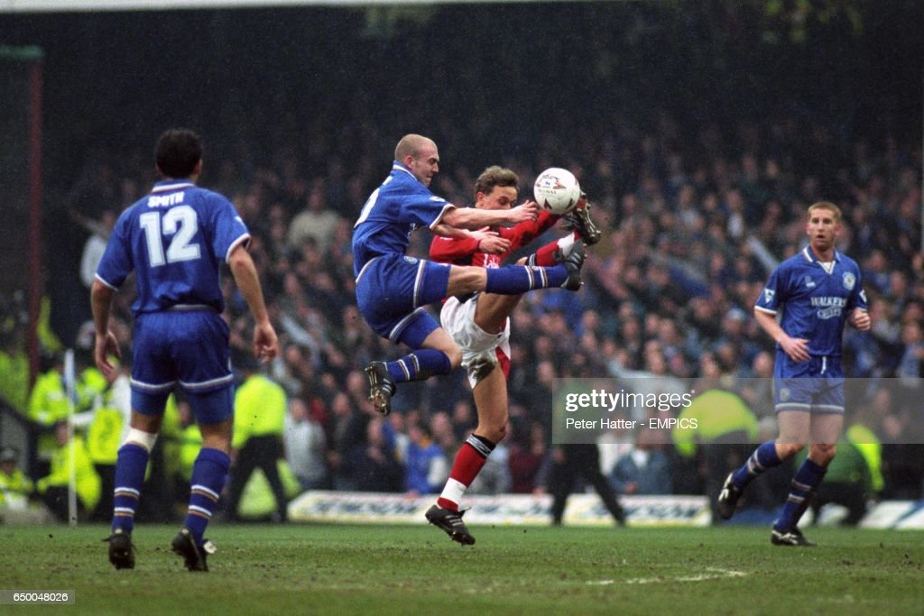 Leicester City's Mark Draper and Nottingham Forest's Lars Bohinen challenge for a high ball, watched by Leicester City's Richard Smith (l) and Iwan Roberts (r).