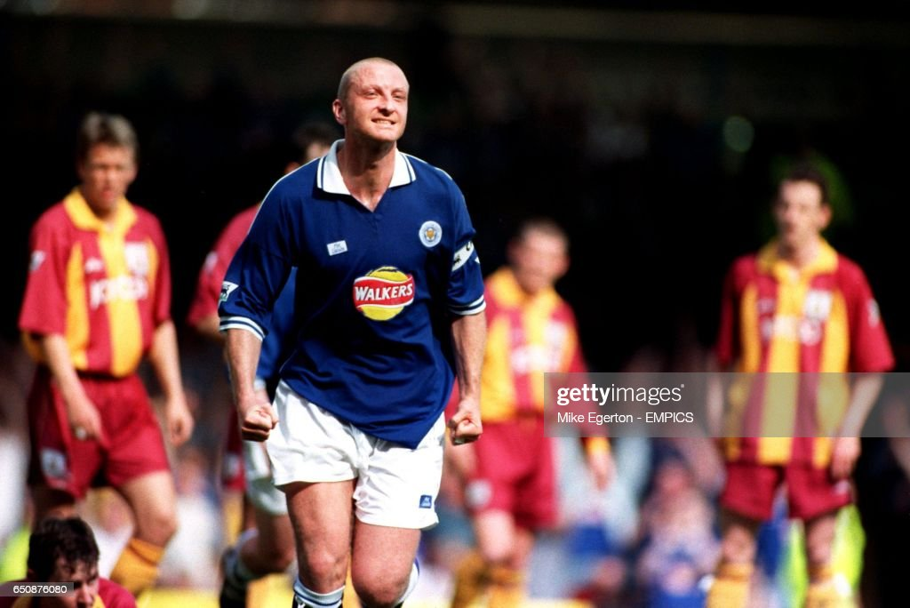 Leicester City's Matt Elliott celebrates the first goal as Bradford City players look on in dejection