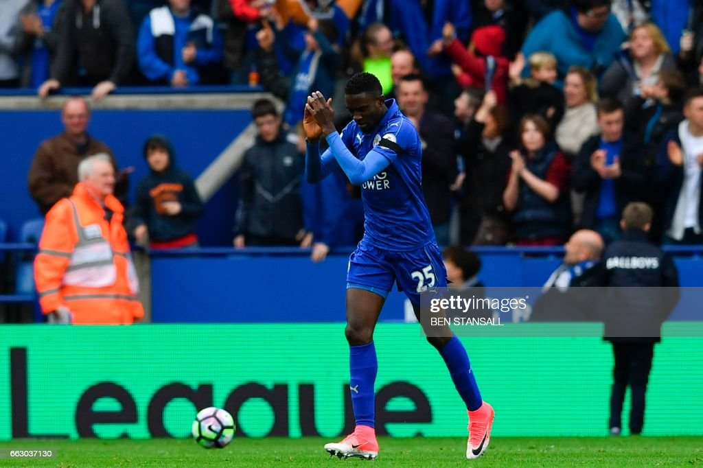 Leicester City's Nigerian midfielder Wilfred Ndidi celebrates scoring the opening goal during the English Premier League football match between Leicester City and Stoke City at King Power Stadium in Leicester, central England on April 1, 2017. / AFP PHOTO / Ben STANSALL / RESTRICTED TO EDITORIAL USE. No use with unauthorized audio, video, data, fixture lists, club/league logos or 'live' services. Online in-match use limited to 75 images, no video emulation. No use in betting, games or single club/league/player publications. /