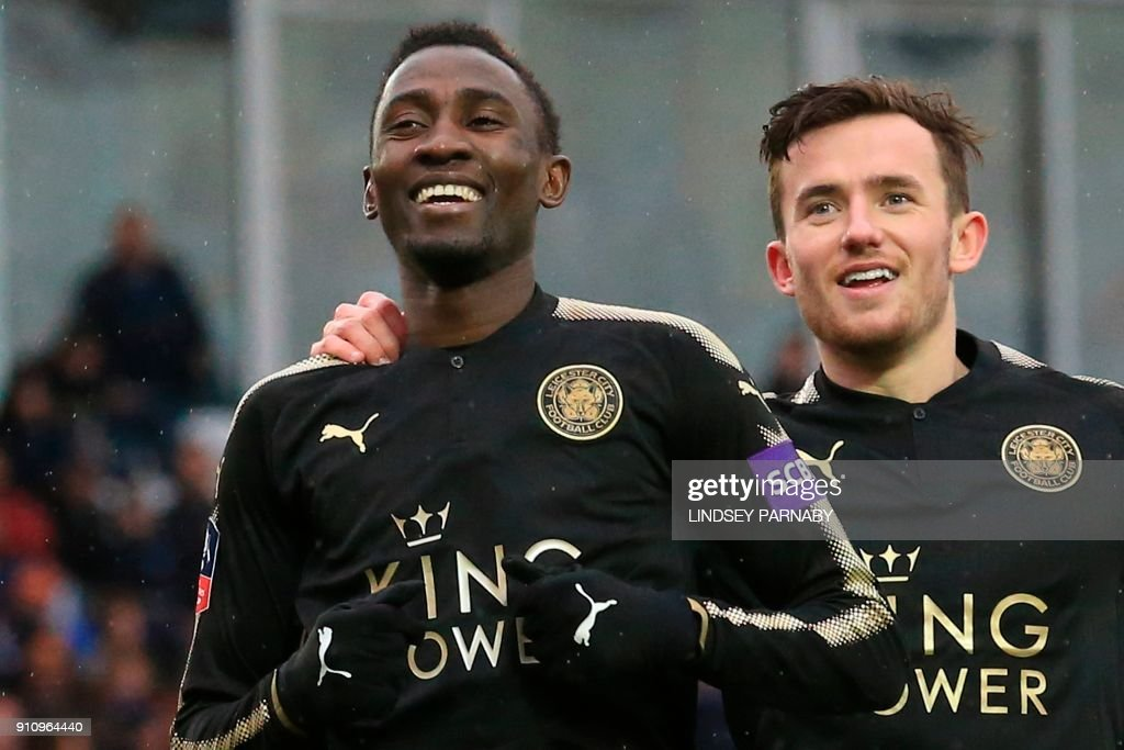 Leicester City's Nigerian midfielder Wilfred Ndidi (L) celebrates scoring their fifth goal during the English FA Cup fourth round football match between Peterborough United and Leicester City at London Road stadium in Peterborough, eastern England, on January 27, 2018. / AFP PHOTO / Lindsey PARNABY / RESTRICTED TO EDITORIAL USE. No use with unauthorized audio, video, data, fixture lists, club/league logos or 'live' services. Online in-match use limited to 75 images, no video emulation. No use in betting, games or single club/league/player publications. /