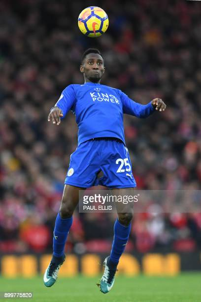 Leicester City's Nigerian midfielder Wilfred Ndidi heads the ball during the English Premier League football match between Liverpool and Leicester at...