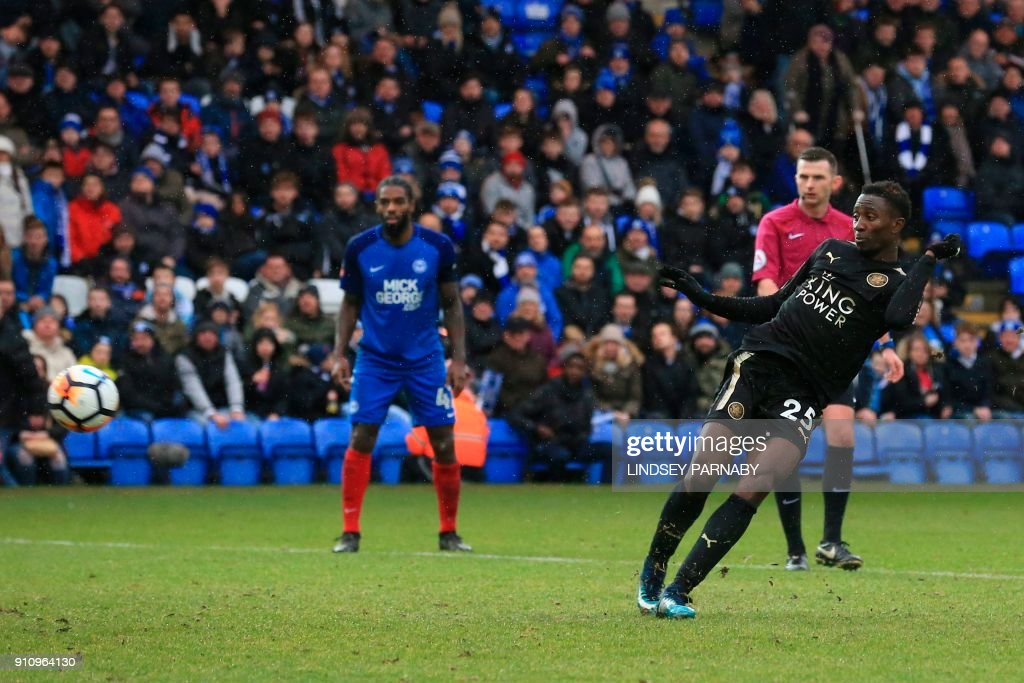 Leicester City's Nigerian midfielder Wilfred Ndidi score their fifth goal during the English FA Cup fourth round football match between Peterborough United and Leicester City at London Road stadium in Peterborough, eastern England, on January 27, 2018. / AFP PHOTO / Lindsey PARNABY / RESTRICTED TO EDITORIAL USE. No use with unauthorized audio, video, data, fixture lists, club/league logos or 'live' services. Online in-match use limited to 75 images, no video emulation. No use in betting, games or single club/league/player publications. /