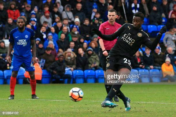 Leicester City's Nigerian midfielder Wilfred Ndidi score their fifth goal during the English FA Cup fourth round football match between Peterborough...