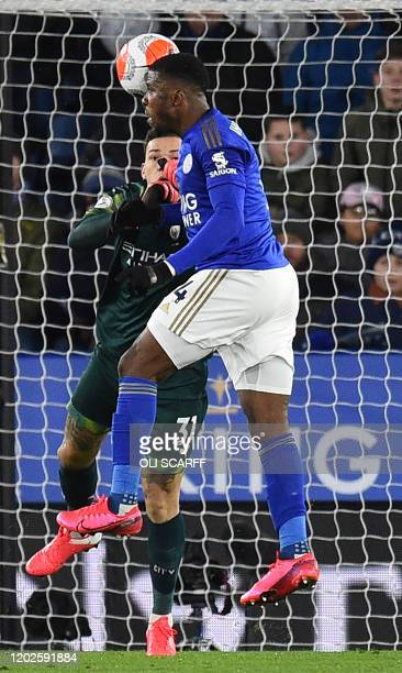 Leicester City's Nigerian striker Kelechi Iheanacho and Manchester City's Brazilian goalkeeper Ederson collide during the English Premier League...