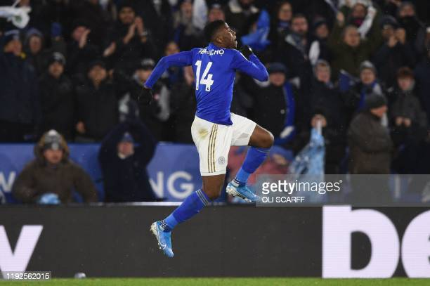 Leicester City's Nigerian striker Kelechi Iheanacho celebrates scoring his team's first goal during the English League Cup semifinal first leg...