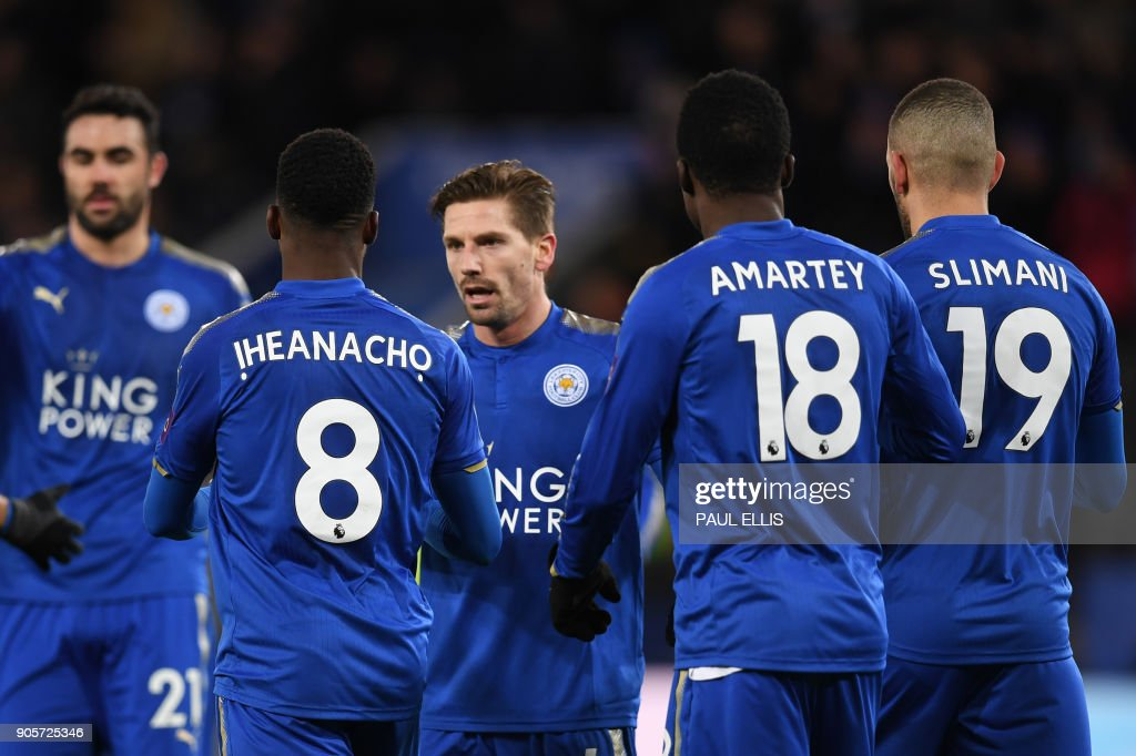 Leicester City's Nigerian striker Kelechi Iheanacho celebrates scoring the team's first goal, with teammates during the English FA Cup third round replay football match between Leicester City and Fleetwood Town at King Power Stadium in Leicester, central England on January 16, 2018. / AFP PHOTO / Paul ELLIS / RESTRICTED TO EDITORIAL USE. No use with unauthorized audio, video, data, fixture lists, club/league logos or 'live' services. Online in-match use limited to 75 images, no video emulation. No use in betting, games or single club/league/player publications. /
