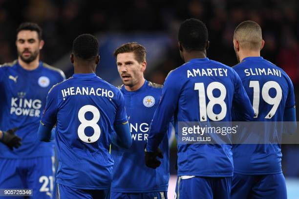 Leicester City's Nigerian striker Kelechi Iheanacho celebrates scoring the team's first goal with teammates during the English FA Cup third round...