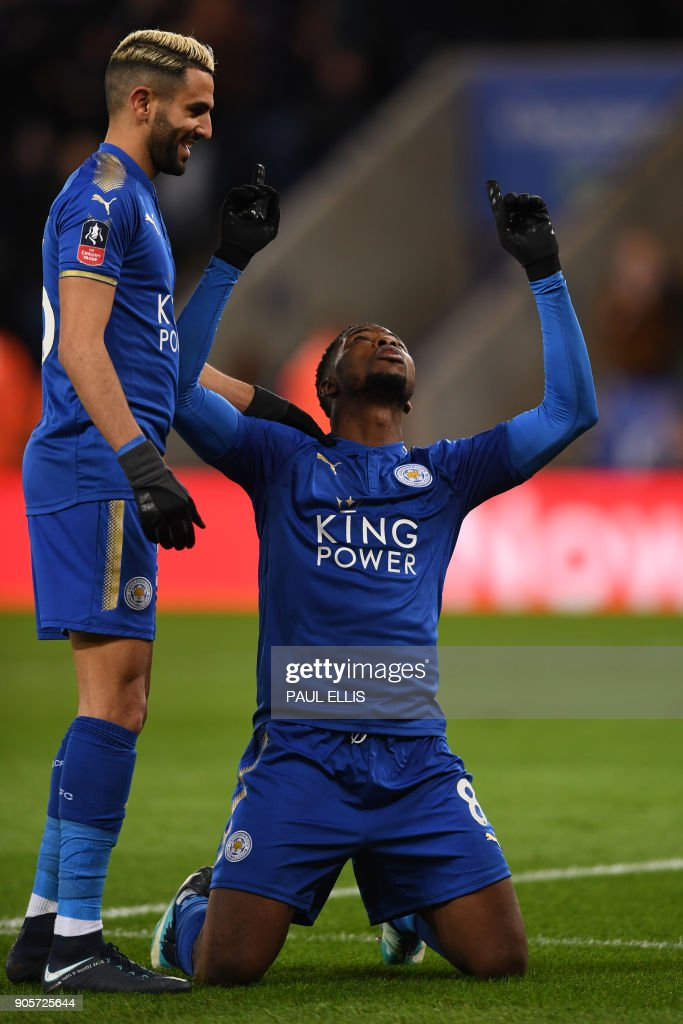 Leicester City's Nigerian striker Kelechi Iheanacho (R) celebrates scoring the team's first goal, with Leicester City's Algerian midfielder Riyad Mahrez during the English FA Cup third round replay football match between Leicester City and Fleetwood Town at King Power Stadium in Leicester, central England on January 16, 2018. / AFP PHOTO / Paul ELLIS / RESTRICTED TO EDITORIAL USE. No use with unauthorized audio, video, data, fixture lists, club/league logos or 'live' services. Online in-match use limited to 75 images, no video emulation. No use in betting, games or single club/league/player publications. /
