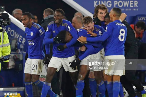 Leicester City's Nigerian striker Kelechi Iheanacho celebrates with teammates after scoring their late winning goal during the English Premier League...