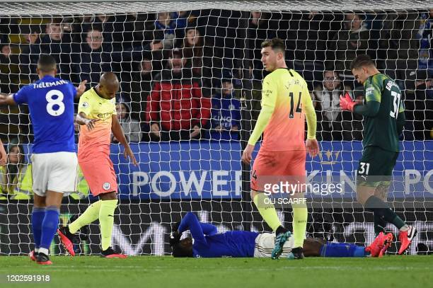 Leicester City's Nigerian striker Kelechi Iheanacho lies injured after colliding with Manchester City's Brazilian goalkeeper Ederson during the...