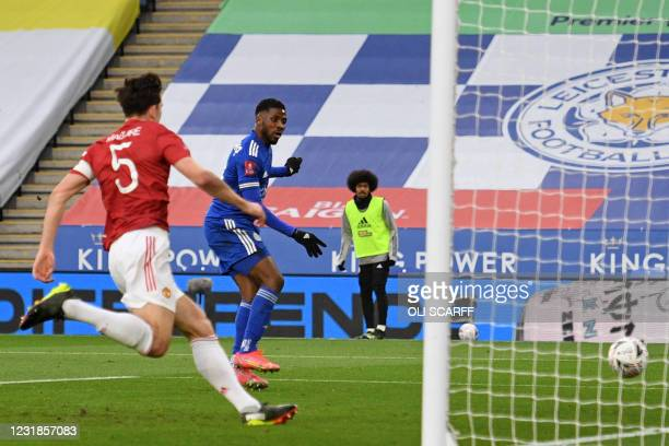 Leicester City's Nigerian striker Kelechi Iheanacho scores the opening goal of the English FA Cup quarter-final football match between Leicester City...