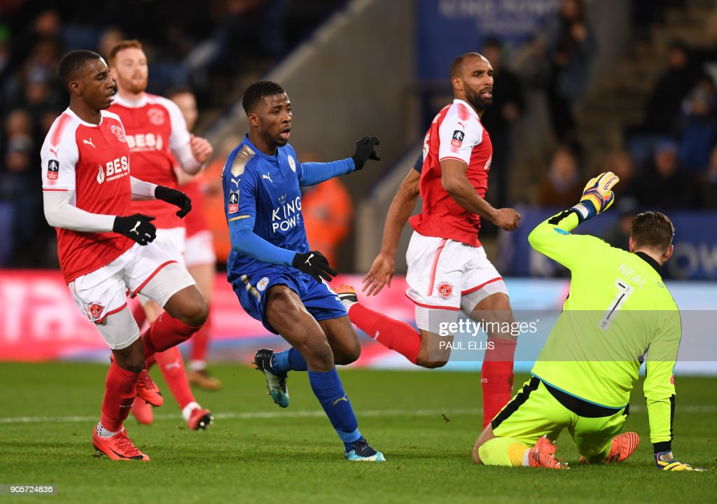Leicester City's Nigerian striker Kelechi Iheanacho (C) scores the team's first goal past Fleetwood Town's English goalkeeper Chris Neal (R) during the English FA Cup third round replay football match between Leicester City and Fleetwood Town at King Power Stadium in Leicester, central England on January 16, 2018. / AFP PHOTO / Paul ELLIS / RESTRICTED TO EDITORIAL USE. No use with unauthorized audio, video, data, fixture lists, club/league logos or 'live' services. Online in-match use limited to 75 images, no video emulation. No use in betting, games or single club/league/player publications. /