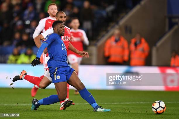 Leicester City's Nigerian striker Kelechi Iheanacho scores the team's first goal past Fleetwood Town's English goalkeeper Chris Neal during the...