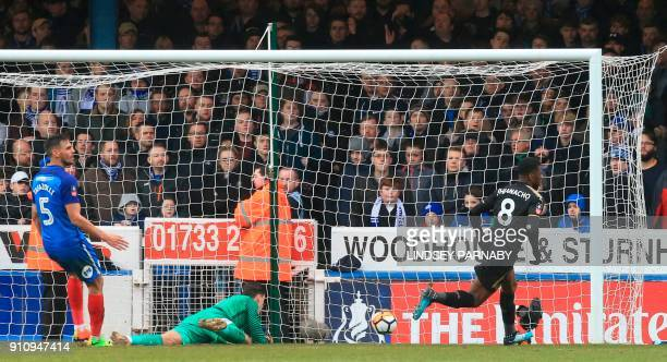 Leicester City's Nigerian striker Kelechi Iheanacho scores their third goal during the English FA Cup fourth round football match between...