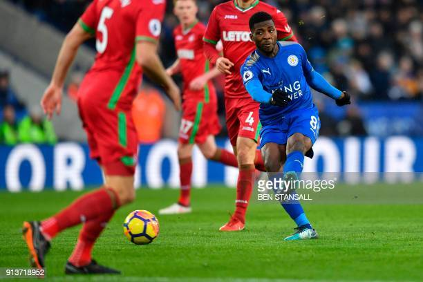 Leicester City's Nigerian striker Kelechi Iheanacho takes a shot that was saved during the English Premier League football match between Leicester...