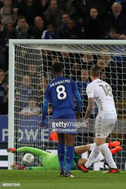 Leicester City's Nigerian striker Kelechi Iheanacho watches as his shot beats Leeds United's German goalkeeper Felix Wiedwald for their first goal...