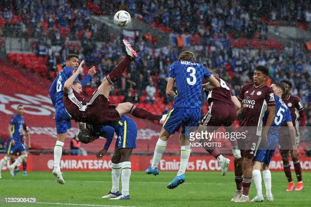 Leicester City's Northern Irish defender Jonny Evans attempts an overhead kick as Leicester City's Turkish defender Caglar Soyuncu heads over during...
