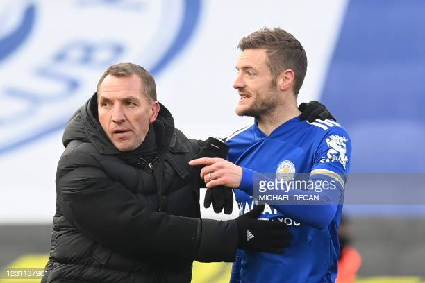 Leicester City's Northern Irish manager Brendan Rodgers and Leicester City's English striker Jamie Vardy react at the final whistle during the...