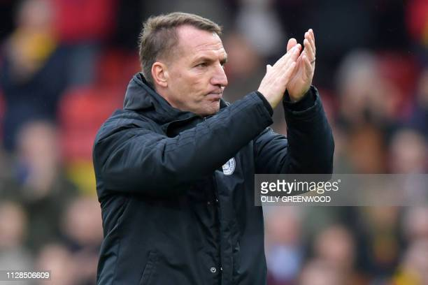 Leicester City's Northern Irish manager Brendan Rodgers applauds supporters on the pitch after the English Premier League football match between...